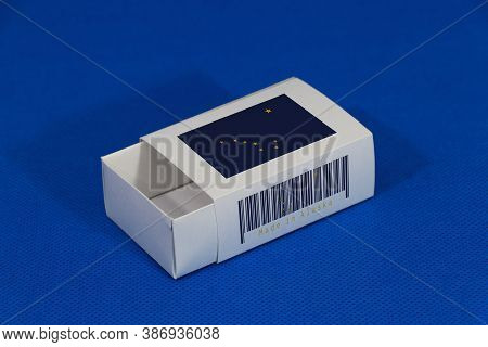 Alaska Flag On White Box With Barcode And The Color Of State Flag On Blue Background, Paper Packagin