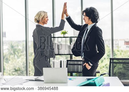Group Of Successful People Giving Hi Five Together