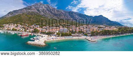 Adriatic Town Of Baska Voda Beaches And Waterfront Aerial Panoramic View, Dalmatia Region Of Croatia