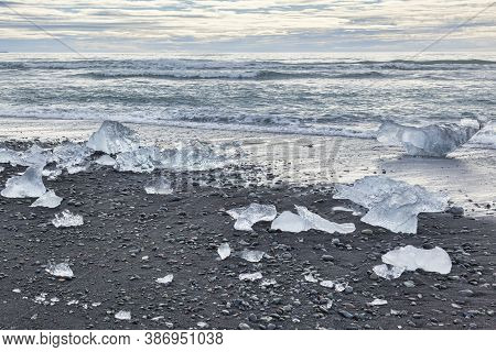 Diamond Beach, South Iceland, Where Ice From Jokulsarlon Glacial Lagoon Is Deposited On The Volcanic