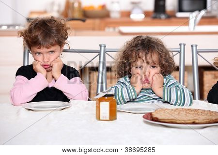 Kids pouting in the kitchen