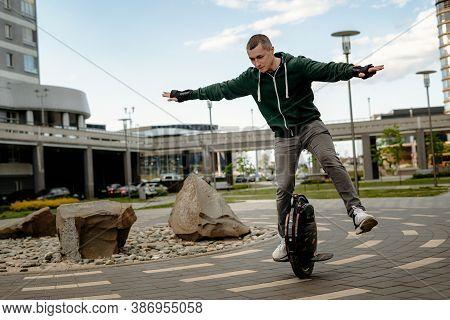 Man Riding Electric Mono Cycle On Street, Aerobatics, Figure