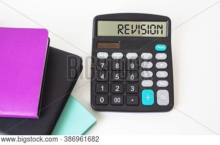 Revision, Text On The Calculator. Colored Notepads On White Background