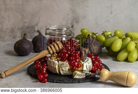 Mouthwatering Oven Baked Camembert With Berries, Honey, And Figs.