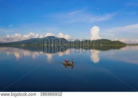 Fisherman With Boat In Bang Pra Reservoir Dam. National Park With Reflection Of River Lake, Mountain