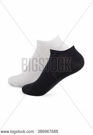 Set Of Socks White And Black Color Isolated On White Background. One Pair Of Socks In Different Colo