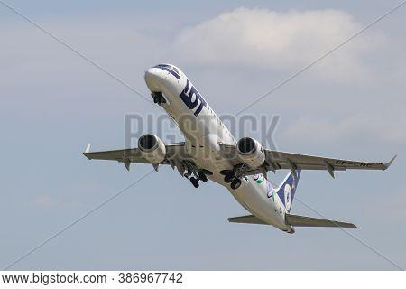 29 July 2020 - Warsaw, Poland: Polish Airlines Lot Embraer 195 Lr Jetliner On The Climbout After Tak