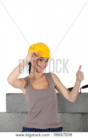 Female stonemason giving the thumb's up