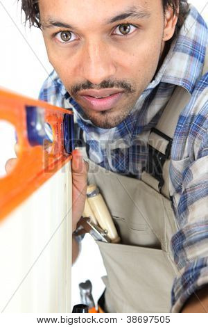 Tradesman using a bubble level