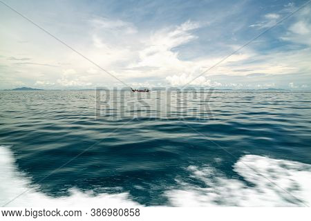 Longtail Fishing Boat In The Tropical Sea