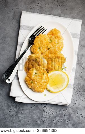 Homemade Fish Cakes With French Fries On White Plate Close Up