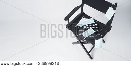 Director Chair And Face Mask And Black Clapper Board Or Movie Slate. It Use In Video Production And