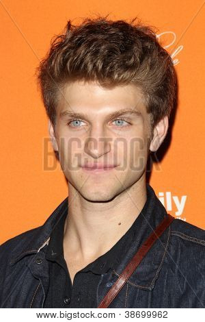 """LOS ANGELES - OCT 16:  Keegan Allen arrives at  """"Pretty Little Liars"""" Special Halloween Episode Screening at Hollywood Forever Cemetery on October 16, 2012 in Los Angeles, CA"""