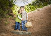Adorable Brother and Sister Children with Basket Hugging Outside. poster
