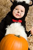 Small child in skunk costume for halloween poster