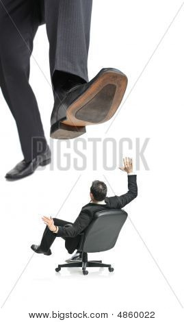 A giant foot about to squish a businessman in a chair isolated on a white background poster