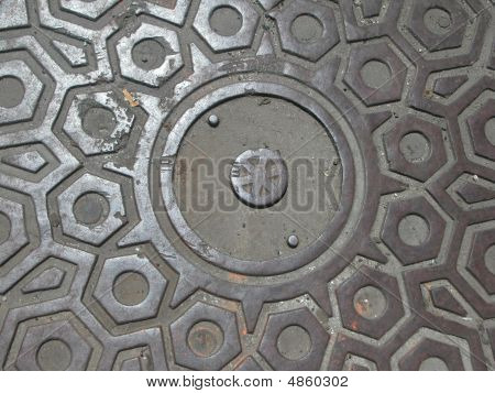 Manhole cover in Manhattan. Text is cleared fo room to write. poster