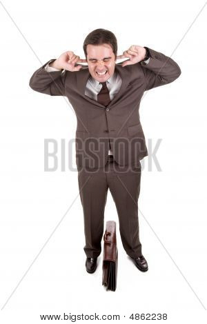 Businessman Covering His Ears With His Fingers