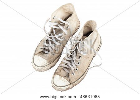 Old Sneakers On White Background.