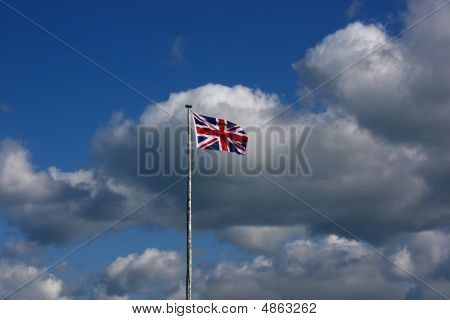 Union Flag on a windy day. This is the flag generally regarded to represent the peoples of England Scotland Wales and Northern Ireland. The image may show the effect of the wind at full size. poster