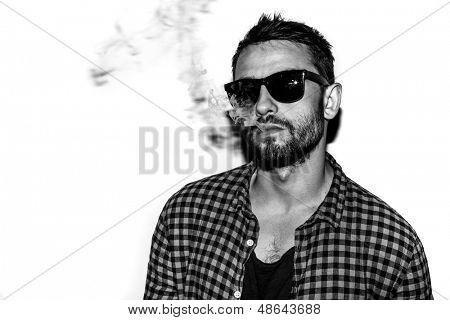 man smoking cigarette black and white portrait