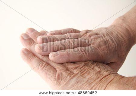 wrinkled skin on older man hands
