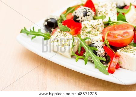 Fresh Salad With Feta Cheese With Herbs Closeup