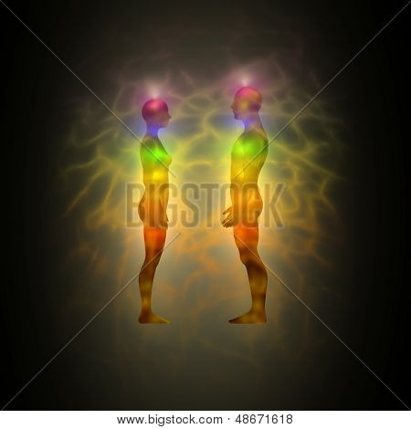 Human energy body silhouette with aura and chakras
