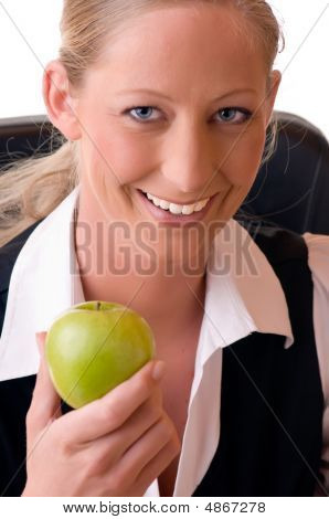 Young Woman Holds An Apple In Her Hand