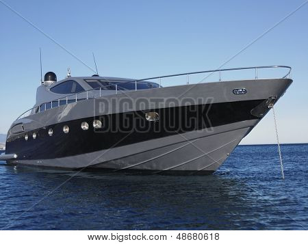 Close up of yacht moored in sea against clear blue sky