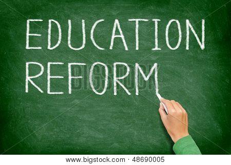Education reform - school reform concept blackboard. Teacher or student writing EDUCATION REFORM on green chalkboard. Primary school, secondary school, high school or college university.