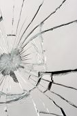 Macro of a shattered mirror - broken glass. poster