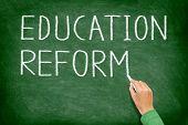 Education reform - school reform concept blackboard. Teacher or student writing EDUCATION REFORM on green chalkboard. Primary school, secondary school, high school or college university. poster