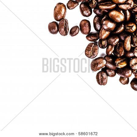 Close Up Of Roasted Coffee Beans  Heap. Coffee Beans Background Texture Isolated On White Background