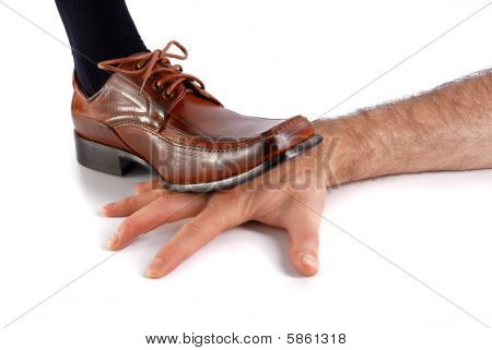 Foot Stepping On A Hand