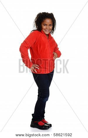 little girl posing with red top