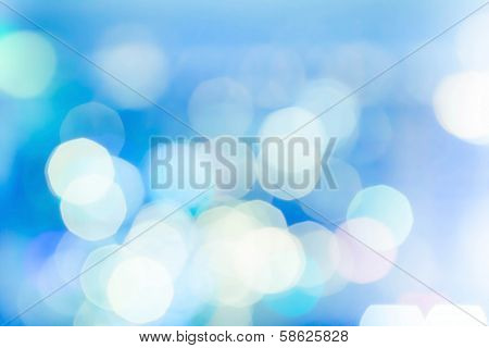 Blue Lights Festive Background. Abstract Holiday Twinkled Bright Background With Natural Bokeh Defoc