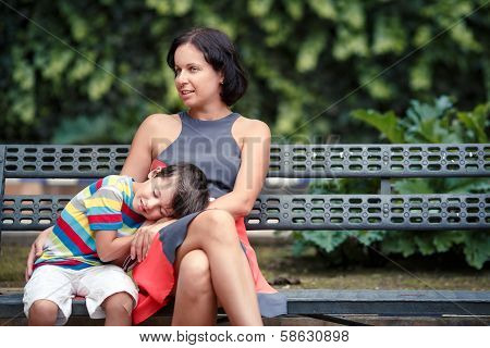 Portrait of mother and son sitting outdoors