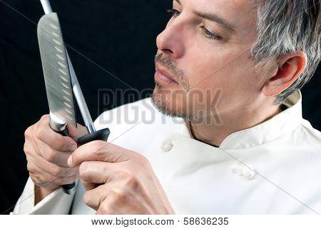 Chef Sharpens Knife