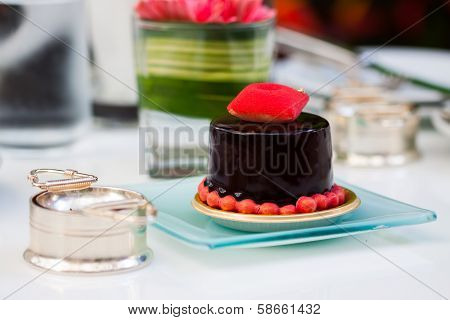 Piece of chocolate cake with icing on white isolated background