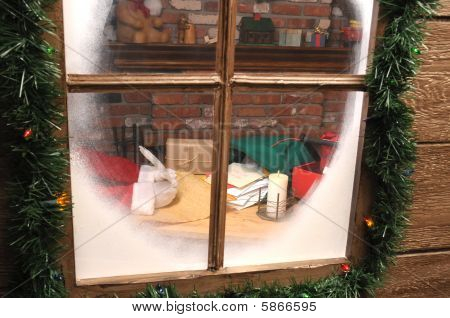 Santa Claus In Workshop With Quill Pen And Naughty List