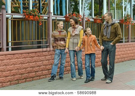Family walking in the city