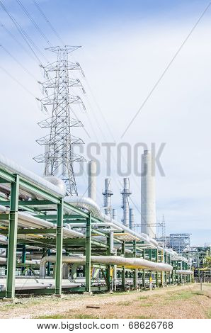 High-voltage Transmission Tower With Pipe Rack In Industrial Estate.