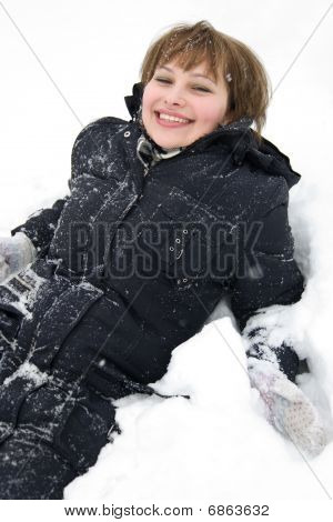 Smiling Girl Laying In Snow
