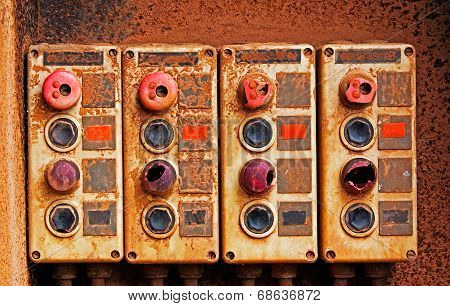 Old Electric Switches On Rusty Iron Wall