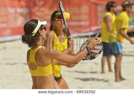 MOSCOW, RUSSIA - JULY 16, 2014: Joana Cortez and other members of Brazil team on the training before the ITF Beach Tennis World Team Championship. Russia hosts the championship for the third time
