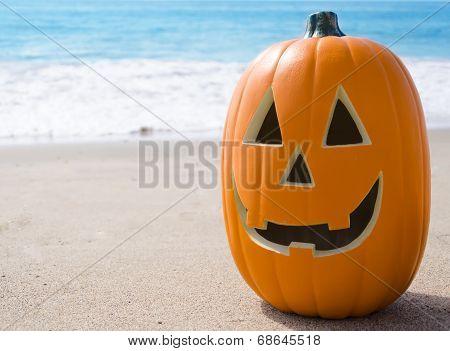 Halloween Pumpkin On The Beach