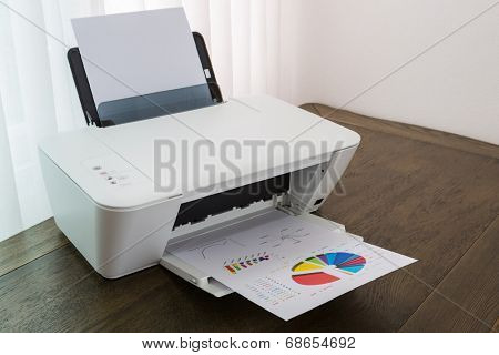Printer with financial documents on a wood table