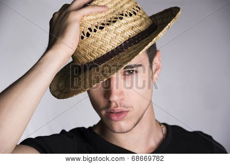 Handsome Sultry Sexy Young Man With Straw Hat