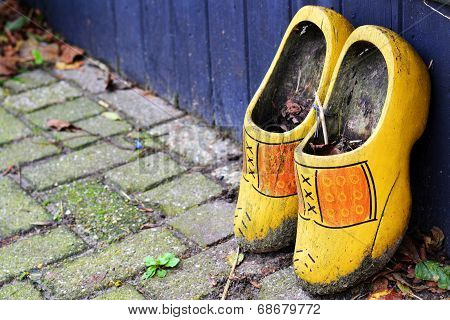 Dirty Dutch clogs left outside